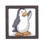 Pingüino que agita su mano cajas de recuerdo de calidad