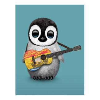 Pingüino que juega el azul de la guitarra de la tarjeta postal