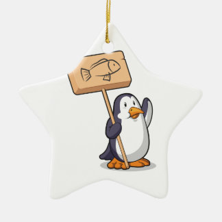 Pingüino que lleva a cabo una muestra de madera adorno navideño de cerámica en forma de estrella