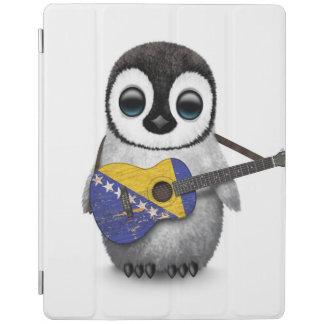 Pingüino que toca la guitarra de la bandera de cover de iPad