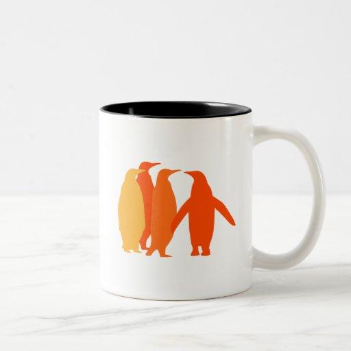 Pingüinos anaranjados tazas de café