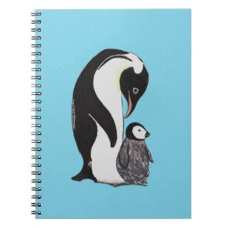 Pingüinos con el cuaderno azul