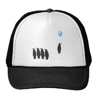 Pingüinos con el gorra del globo