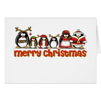 Pingüinos de las Felices Navidad Tarjetón