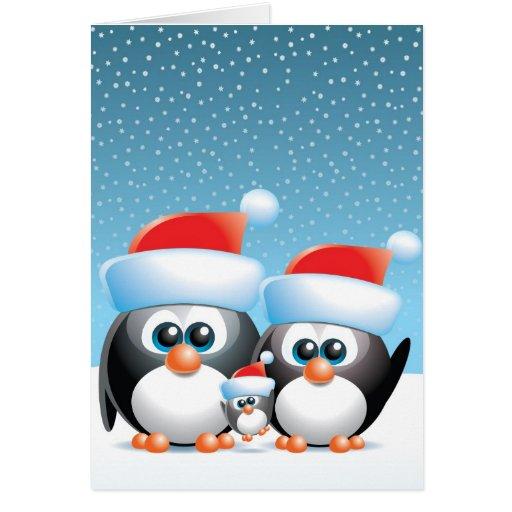 Pingüinos del navidad con el bebé tarjeta de felicitación