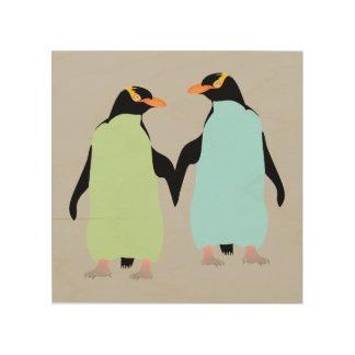 Pingüinos del orgullo gay que llevan a cabo las cuadros de madera