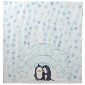 Pingüinos en iglú mientras que nieva servilletas de papel
