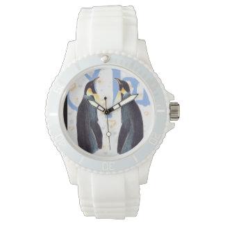 Pingüinos en reloj deportivo del amor