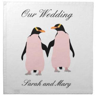 Pingüinos lesbianos del orgullo gay que llevan a servilletas imprimidas