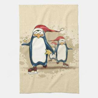 Pingüinos patinadores del navidad toalla de cocina