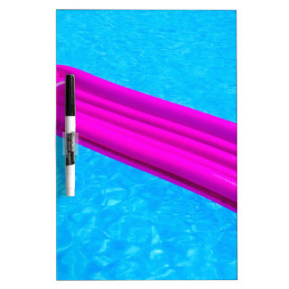 Pink air mattress on water of swimming pool dry erase board