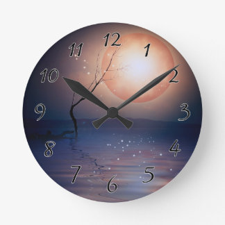 Pink and Blue Fantasy Sparkling Moon over water Round Clock