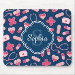 "Pink and Blue Nurse Pattern with Monogram Mouse Pad<br><div class=""desc"">Nurse themed pattern design in pink,  white,  and navy blue,  with a blue and white quatrefoil label featuring a monogram initial letter / name template.  A cute,  feminine design that is perfect for celebrating a special RN during nurses week.</div>"