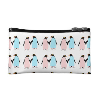 Pink and blue Penguins holding hands. Makeup Bags