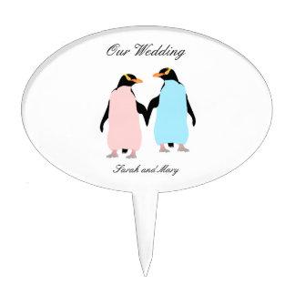 Pink and blue Penguins holding hands. Cake Topper