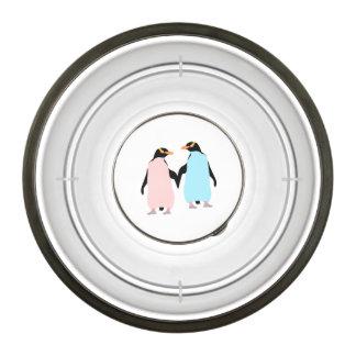 Pink and blue Penguins holding hands. Pet Bowl