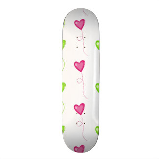 Pink and Green Heart Balloons on White Skateboards