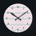 """Pink and grey chevron baby girl nursery clock<br><div class=""""desc"""">This modern pink and grey clock is available in square or round.  Numbers can be removed.  Need a specific color for your decor?  Just ask the designer!  Feel free to contact us anytime with questions.</div>"""