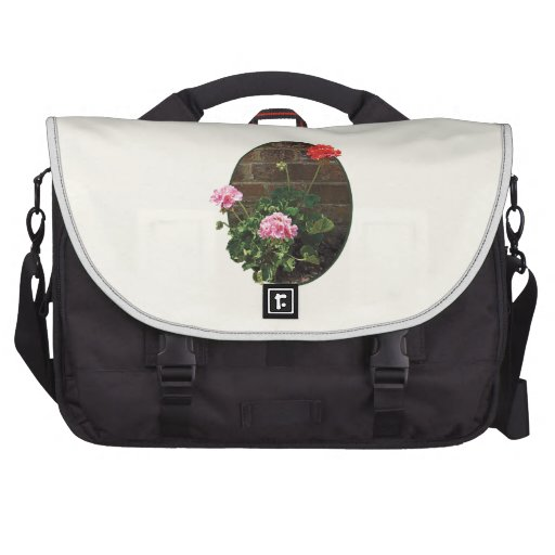 Pink and Red Geraniums Against Brick Computer Bag