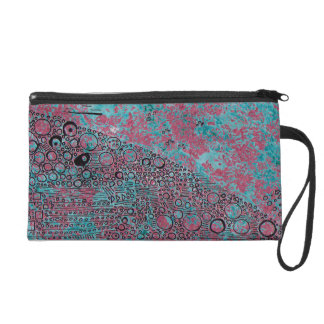 Pink and teal with lines and circles. wristlet