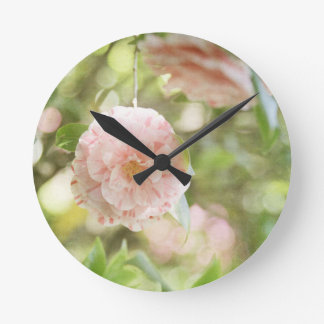 Pink and White Camillia Flowers on Green Flowers Round Clock