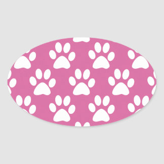 Pink and white puppy paws pattern oval sticker
