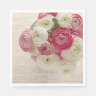 Pink and white ranunculus on script paper napkin