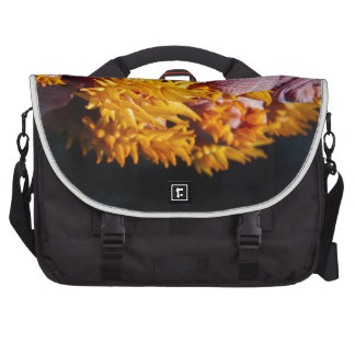Pink and yellow coral flowers commuter bag