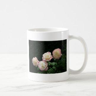 Pink and yellow rose blooms coffee mug
