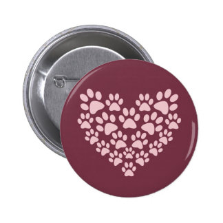 Pink animal paw prints heart design button