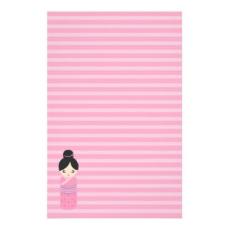 Pink Asian Doll Against Pink Stationery