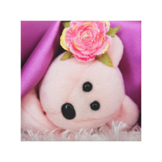 PINK BEAR UNDER A PURPLE SATIN BLANKET CANVAS PRINT