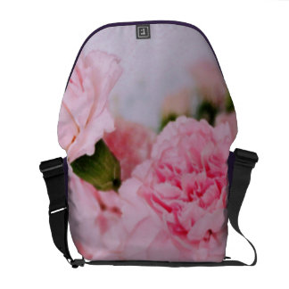 pink carnation flowers vintage style photography. courier bag