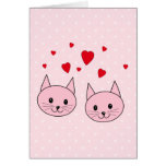 Pink cats with love hearts. greeting card