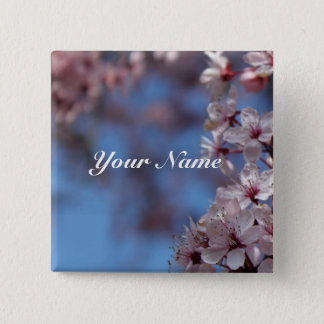 pink cherry blossom in blue sky pinback button