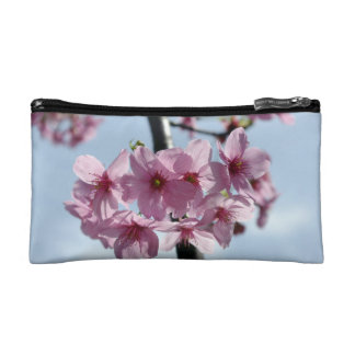 Pink cherry blossoms and light-blue sky makeup bag