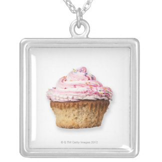 Pink cup cake, on white background, cut out silver plated necklace