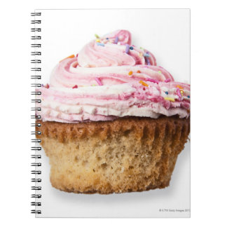 Pink cup cake, on white background, cut out spiral notebook