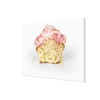 Pink cup cake sat on a porcelain cake stand, on canvas print