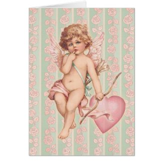 Pink Cupid on Roses Greeting Card