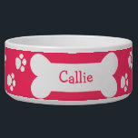 "Pink Dog Bowl With Paws and Bone<br><div class=""desc"">Show your love for your dog with this adorable customizable dog bowl. Features dog paw prints and a bone and can be personalized with your dogs name.</div>"