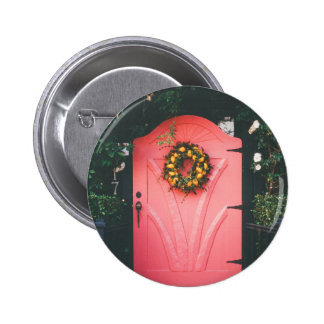 Pink door decorated with yellow flowers 2 inch round button