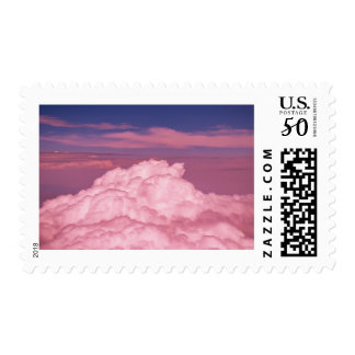 Pink dreamy aerial clouds postage stamp.