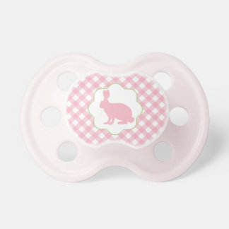 Pink Easter bunny baby pacifier on gingham checks