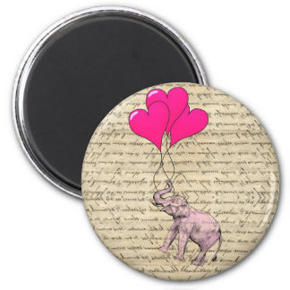 Pink elephant holding balloons 2 inch round magnet