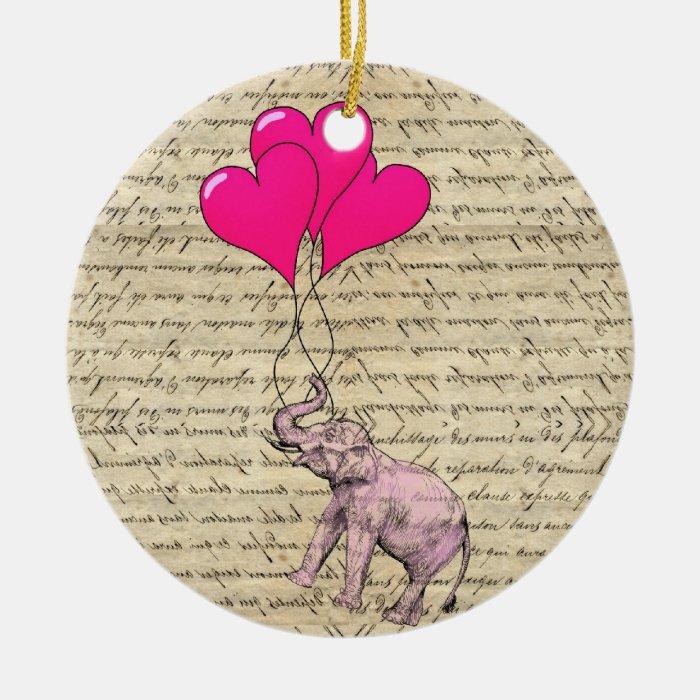 Pink elephant holding balloons ceramic ornament