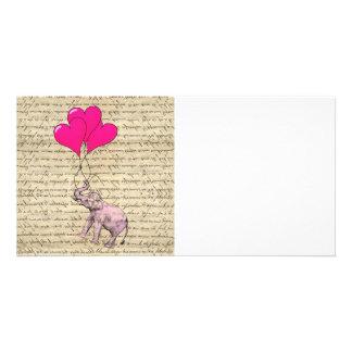 Pink elephant holding balloons photo card