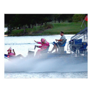 pink fire fighters on airboat in florida flyer