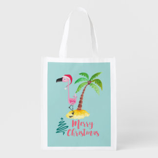 Pink Flamingo In A Santa Hat By A Palm Tree Reusable Grocery Bag