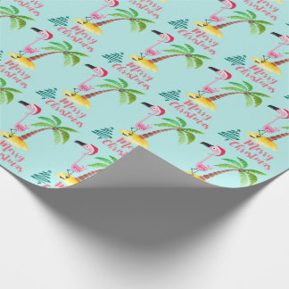 Pink Flamingo In A Santa Hat By A Palm Tree Xmas Wrapping Paper